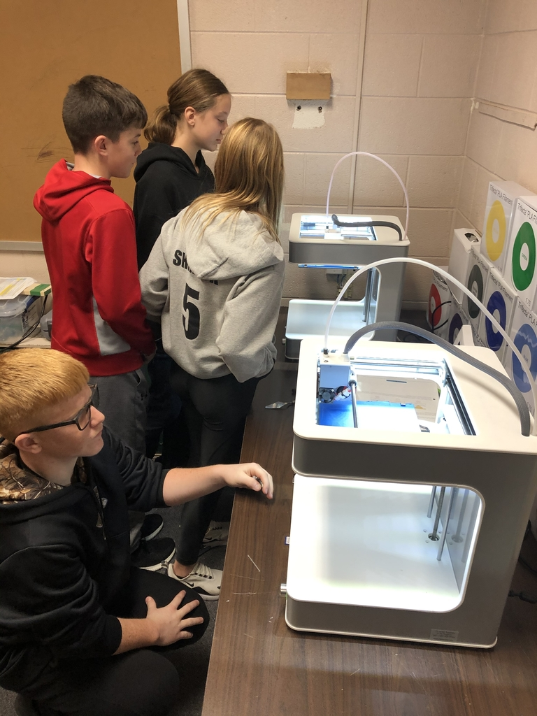 Some of the 7th graders getting ready to 3D print their keychain design