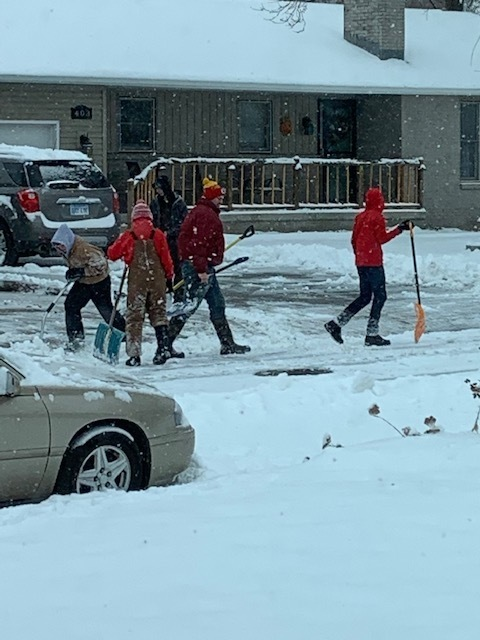 MS basketball team shoveling driveways and sidewalks in the community of Solomon