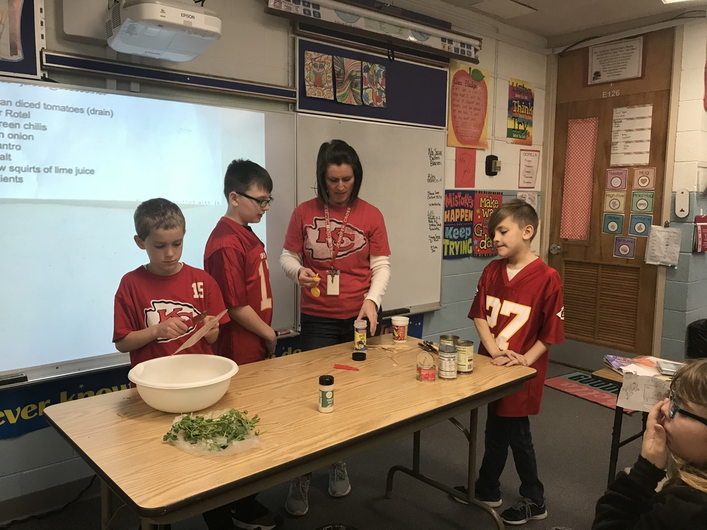 Learning to make salsa before the Chiefs game on Sunday!