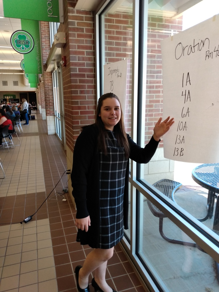 Rachel pointing to her code for finals in oratory