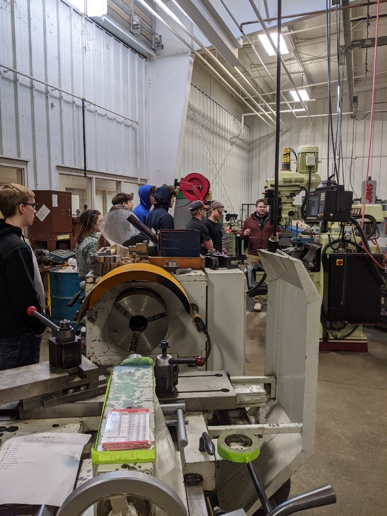 in the machine shop learning about the lathes