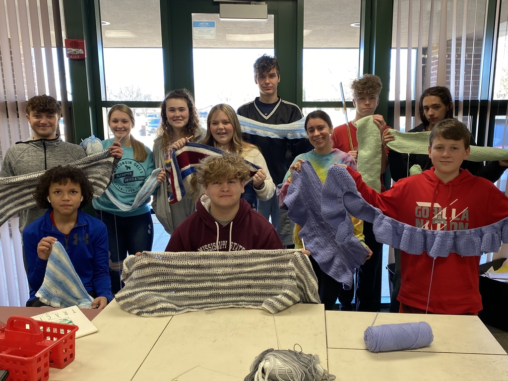 Crafts Students with Final Products